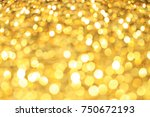 glitter yellow and gold bokeh... | Shutterstock . vector #750672193