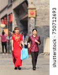 Small photo of BEIJING-JUNE 9, 2015. Traditional dressed women in old city center. Chinese culture is extremely diverse and varying. It is one of the world's oldest cultures, tracing back to thousands of years ago.