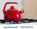 red teapot in kitchen