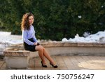 woman sitting on the bench with ... | Shutterstock . vector #750756247