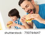 father and son have breakfast...   Shutterstock . vector #750764647