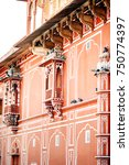 Small photo of Balconies with pigeons on Jaipur City Palace, Rajasthan, India. Maharaja Residence. Old Indian architecture with carving and ornament.
