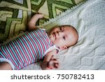 little boy lying on his bed | Shutterstock . vector #750782413