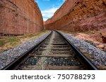 Railway Tracks Lead Into Narro...