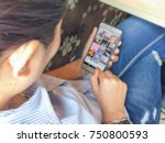 blurry focus of woman is using... | Shutterstock . vector #750800593
