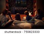 family enjoying movie night at... | Shutterstock . vector #750823333
