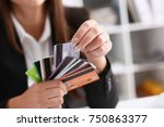 female arm hold bunch of credit ... | Shutterstock . vector #750863377