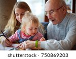 great grandfather showing his... | Shutterstock . vector #750869203