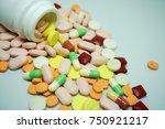 color pill bottle on white...   Shutterstock . vector #750921217