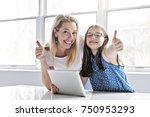 a schoolgirl researching online ... | Shutterstock . vector #750953293
