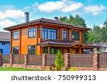 modern facade of wooden house. | Shutterstock . vector #750999313