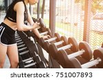 young woman execute exercise in ... | Shutterstock . vector #751007893