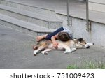 homeless kid sleeping with his... | Shutterstock . vector #751009423