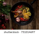 in a pan roast the meat bones... | Shutterstock . vector #751014697
