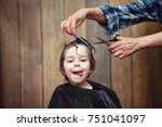 a little boy is trimmed in the... | Shutterstock . vector #751041097