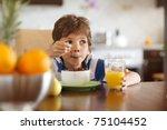 Cute Boy Drinking Orange Juice...