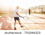 man playing tennis in the... | Shutterstock . vector #751046323