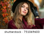 beautiful  girl in claret coat  ... | Shutterstock . vector #751069603