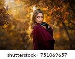 beautiful  girl in claret coat... | Shutterstock . vector #751069657