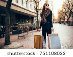 stylish woman standing on the... | Shutterstock . vector #751108033