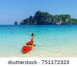 young woman standing with kayak ... | Shutterstock . vector #751172323