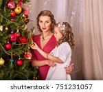 child with mother receiving... | Shutterstock . vector #751231057
