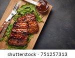 closeup of pork ribs grilled... | Shutterstock . vector #751257313