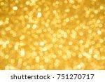 golden blur abstract background.... | Shutterstock . vector #751270717