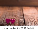 two smiling pink hearts on... | Shutterstock . vector #751276747