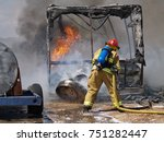A Firefighter Battling To Put...