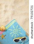 Beach Items On A Towel With...