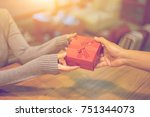 woman hands receiving package... | Shutterstock . vector #751344073