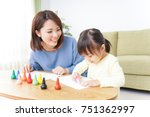 Small photo of A parent and child painting a picture