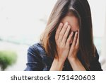 sad woman hug her knee and cry... | Shutterstock . vector #751420603