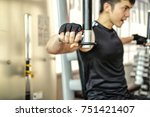 focus fit man exercising at the ... | Shutterstock . vector #751421407
