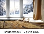 Small photo of Wooden table with space for your product. Curtain in the window. Open window with snowflakes. Landscape of winter forest. Morning sunshine.