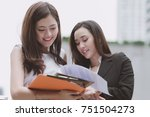 two beautiful confident asian... | Shutterstock . vector #751504273