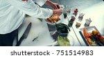 the chef prepares the dish....   Shutterstock . vector #751514983