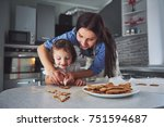 happy family in the kitchen.... | Shutterstock . vector #751594687
