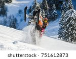 Rider On The Snowmobile In The...