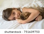 caucasian girl hugging cat on... | Shutterstock . vector #751639753