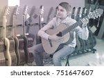 happy teenage boy choosing best ... | Shutterstock . vector #751647607