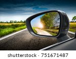 reflected road in rearview...   Shutterstock . vector #751671487