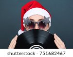 christmas picture. a young... | Shutterstock . vector #751682467