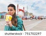 woman drinking soda in coney... | Shutterstock . vector #751702297
