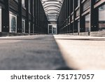 glass and steel long walkway... | Shutterstock . vector #751717057