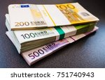 stacks of euro notes on a dark... | Shutterstock . vector #751740943