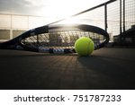 tennis ball and racket on hard... | Shutterstock . vector #751787233