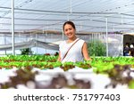 women farmer are taking care of ... | Shutterstock . vector #751797403