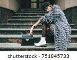 stylish woman in rich fur coat... | Shutterstock . vector #751845733